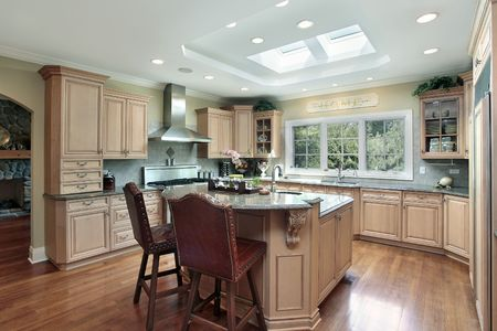 Kitchen in luxury home with oak wood cabinetry Stock Photo - 6740117