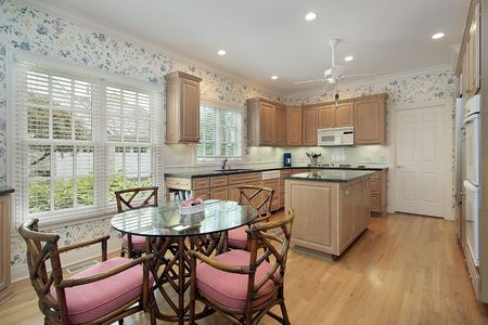 Kitchen in suburban home with oak wood cabinetry Stock Photo - 6740030