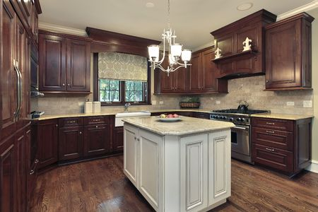 Kitchen in luxury home with white and granite island Stok Fotoğraf