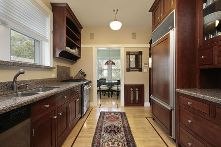 Kitchen in luxury home with wood paneled refrigerator Stock Photo - 6740100