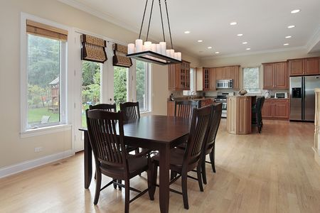 Kitchen in suburban home with large eating area photo