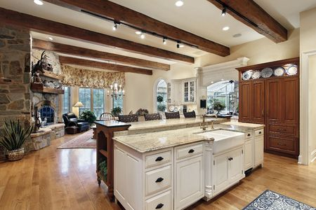kitchen island: Kitchen in luxury home with stone fireplace