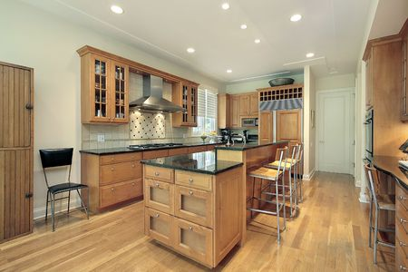 contemporary kitchen: Kitchen in suburban home with oak wood cabinetry Stock Photo