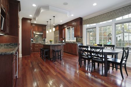 Kitchen in luxury home with cherry wood flooring photo