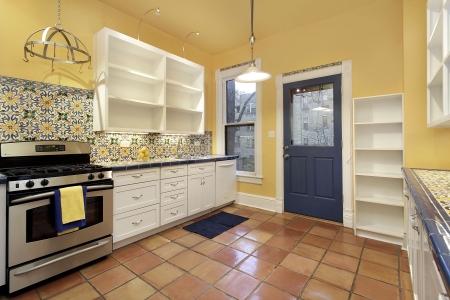 Kitchen in suburban home with terra cotta floor tile photo