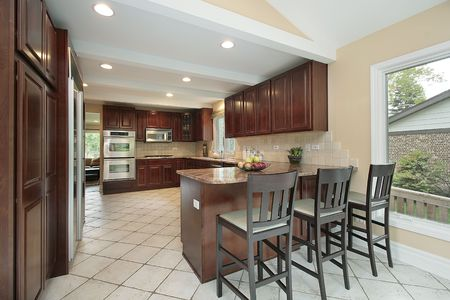 kitchen furniture: Kitchen in suburban home with breakfast bar Stock Photo