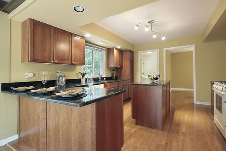 Kitchen in remodeled home with granite counters photo
