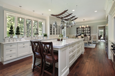Kitchen in luxury home with white granite island photo