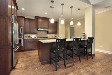 townhome: Kitchen in luxury townhome with breakfast bar