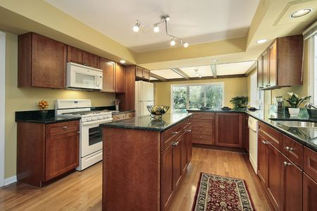 Kitchen in remodeled home with black granite counters Stock Photo - 6740001