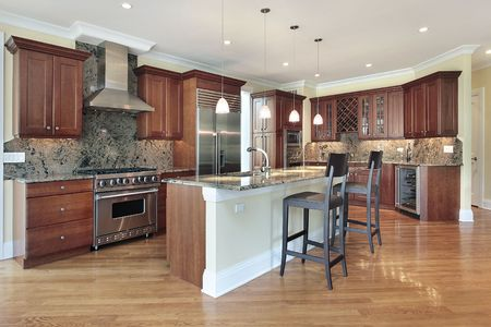 Kitchen in luxury home with large island Stock Photo
