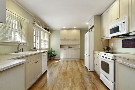 Kitchen in remodeled home with eating area photo