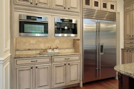 cabinetry: Closeup of luxury kitchen with oak wood cabinetry