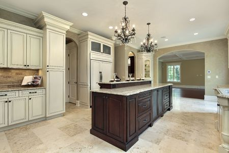 lighting fixtures: Kitchen in new construction home with double deck island