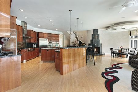 lighting fixtures: Large kitchen in luxury home with black fireplace