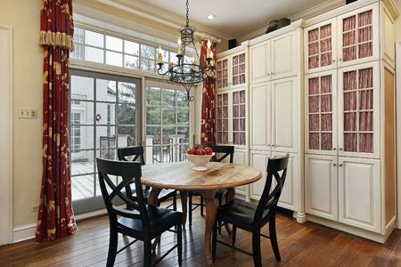 eating area: Eating area in luxury kitchen with doors to deck Stock Photo