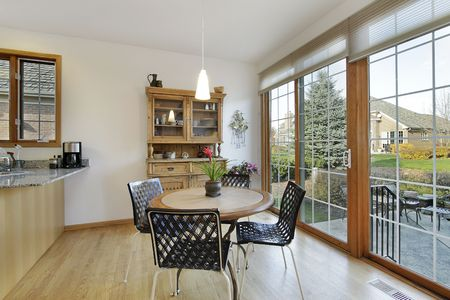 Eating area in suburban home with doors to patio Stock Photo - 6740454