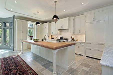 Kitchen with white cabinetry and eating area photo