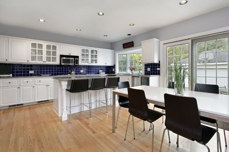 Kitchen in suburban home with blue tile backsplash
