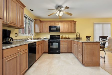 kitchen appliances: Kitchen in suburban home with black appliances