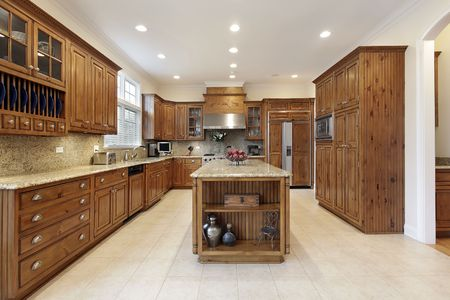 Kitchen in luxury home with granite island photo