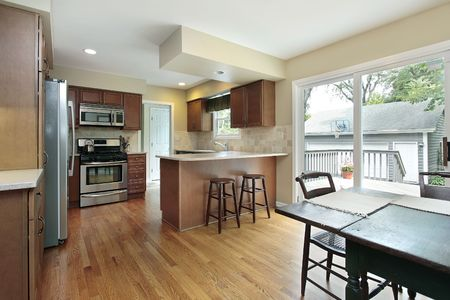 Kitchen in suburban home with deck view