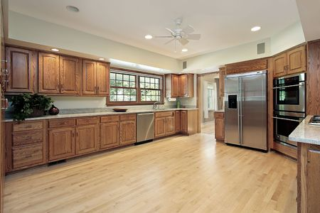 Large kitchen in suburban home with wood cabinetry Stock Photo - 6739876