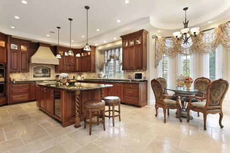 home lighting: Large kitchen in luxury home with eating area
