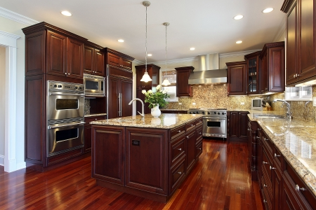 kitchen appliances: Kitchen in luxury home with cherry wood cabinetry Stock Photo