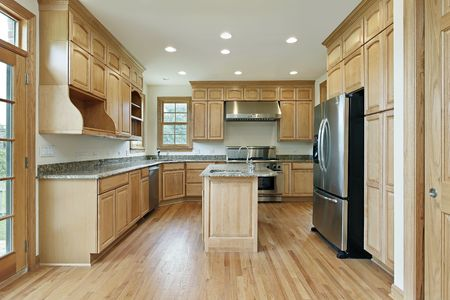 contemporary kitchen: Kitchen in new construction home with oak wood cabinetry