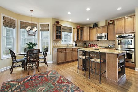 Kitchen in luxury home with eating area photo