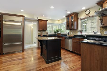 Kitchen in luxury home with black and granite island photo