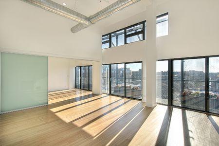Open living room in condominium with balcony view Stock Photo - 6739933