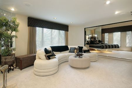 living room furniture: Living room in luxury home with mirrored walls