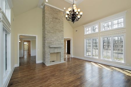 stone fireplace: Living room in new construction home with fireplace