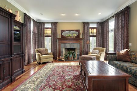 Living room in luxury home with slate fireplace Stock Photo
