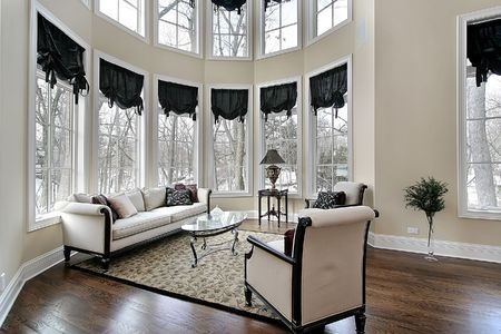 living room interior: Living room in new construction home with curved windoes