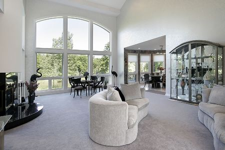 living room sofa: Living room in upscale home with large picture window