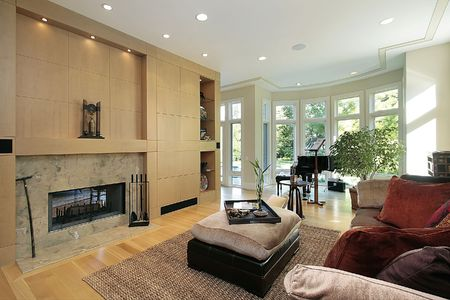 Living room in luxury home with marble fireplace photo