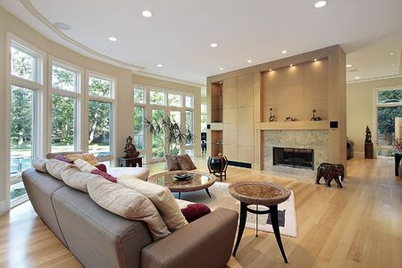 fireplace family: Living room in luxury home with wall of windows Stock Photo