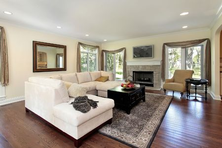 living room sofa: Living room in luxury home with stone fireplace Stock Photo