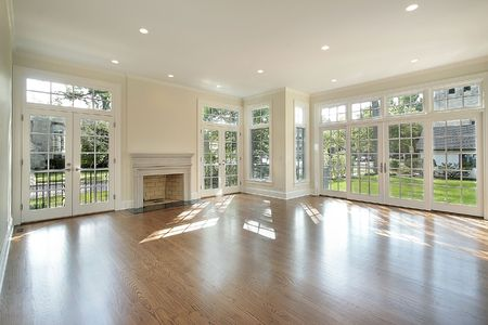 Living room in new construction home with wall of windows Stock Photo
