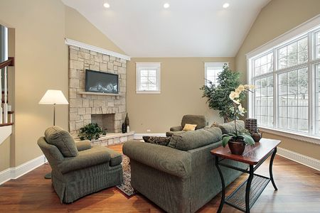 living room interior: Living room in new construction home with stone fireplace
