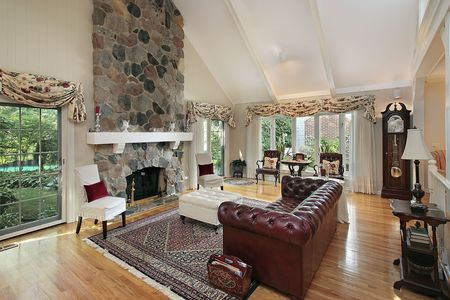 stone fireplace: Living room in home with stone fireplace