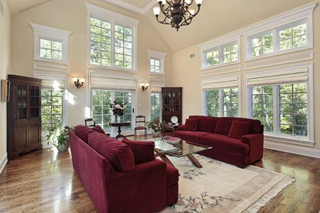 Living room in luxury home with two story windows photo