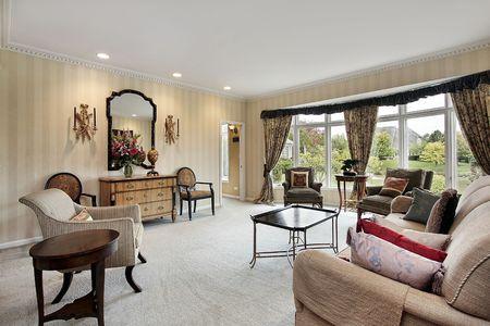 overlooking: Living room with picture window overlooking pond