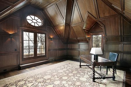 Office in new construction luxury home with dark wood paneling photo