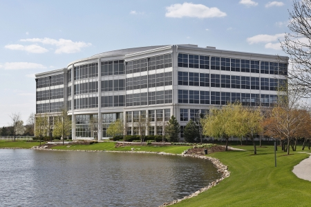 Five story office building with lake in suburbs\ (commercial)