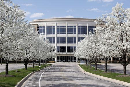 commercial architecture: Office building with blooming trees in spring Stock Photo