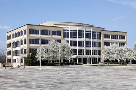 Office building with blooming trees in spring Stock Photo - 6740595